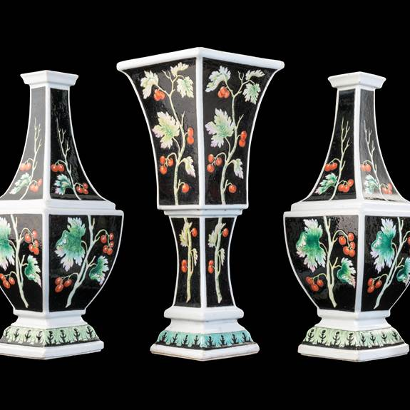 Rare Chinese porcelain garniture of Bottle Vases with black ground from the 'Pronk workshop'