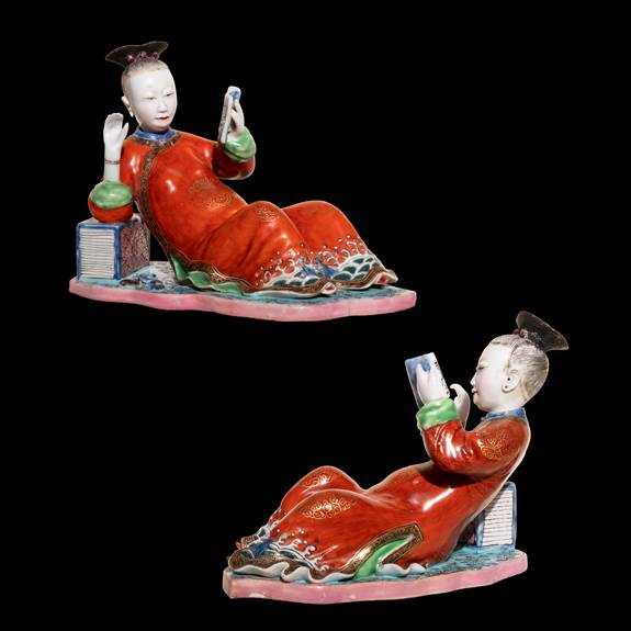 Pair of Chinese porcelain nodding figures of reclining maidens reading books