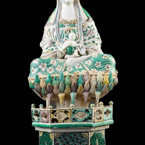 GG: Chinese porcelain famille verte biscuit figure of Guanyin seated on a lotus throne, on a stand