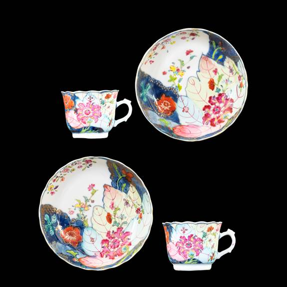 GG: Pair of Chinese export porcelain famille rose cups and saucers with the tobacco leaf pattern