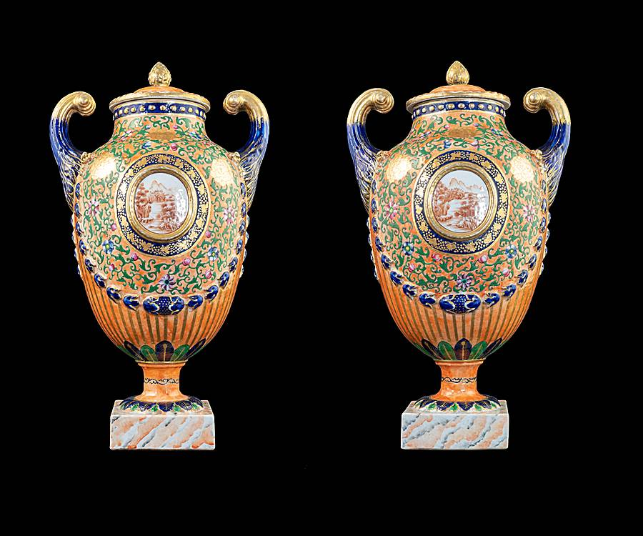 GG: Pair of Chinese export porcelain famille rose pistol handled urns and covers