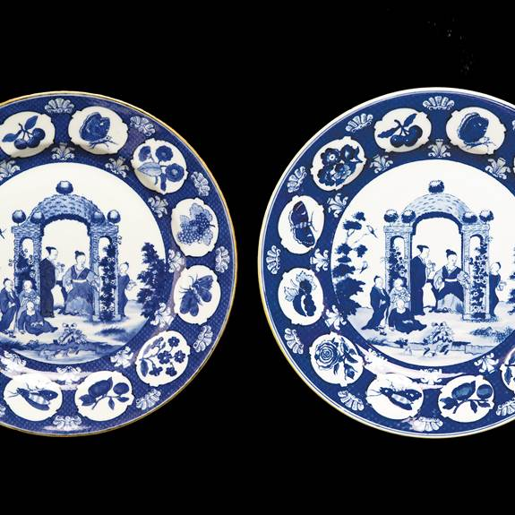 pair of chinese export porcelain blue and white dinner plates with the Pronk Arbour pattern.