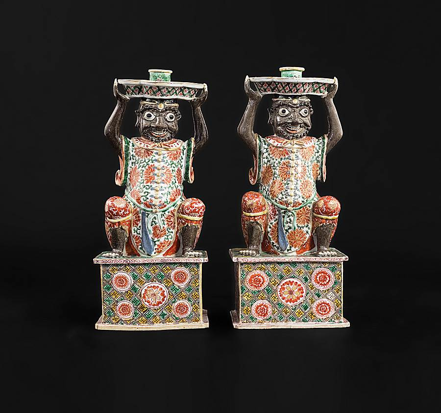 pair of chinese export porcelain famille verte figural candelsticks, modelled as indian bearers