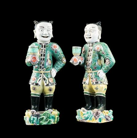 Pair of Chinese export porcelain famille verte figures of boys holding sconces