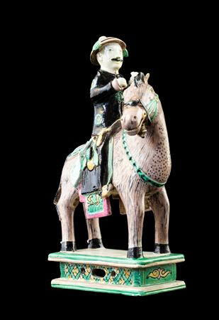 GG: Chinese biscuit porcelain model of a horse and rider