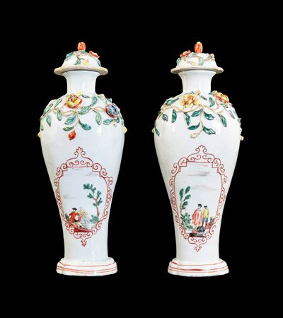 GG: Pair of Chinese soft paste porcelain vases with appliqué, Dutch decorated