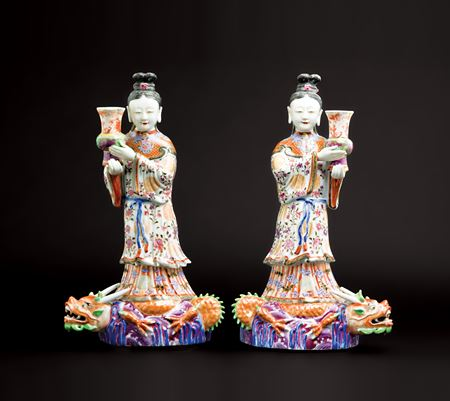 GG: Pair of Chinese porcelain maiden figures modelled as flattened wall sconces with vases