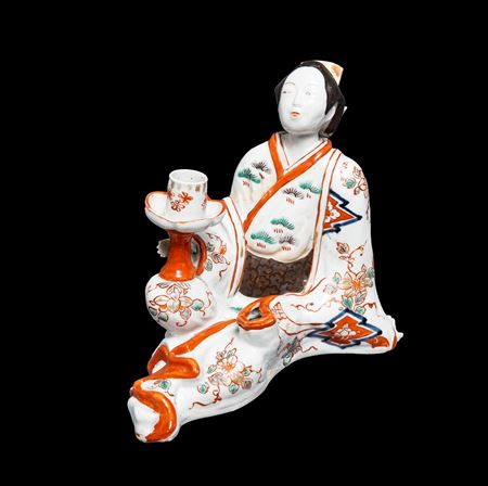Japanese arita porcelain candlestick modelled as a seated bijin