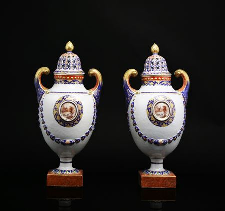 pair of chinese export porcelain pistol handled urns with reticulated covers