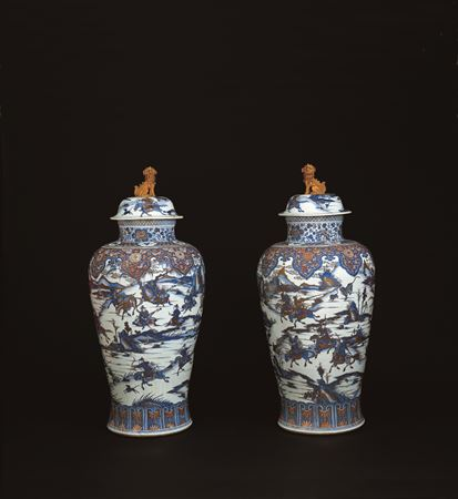 A pair of Imari soldier vases and covers -- THIS ITEM IS SOLD