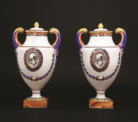 a pair of chinese export porcelain pistol-handled urns