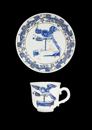 chinese export porcelain teabowl and saucer, 'pronk' design, spaniel and parrot