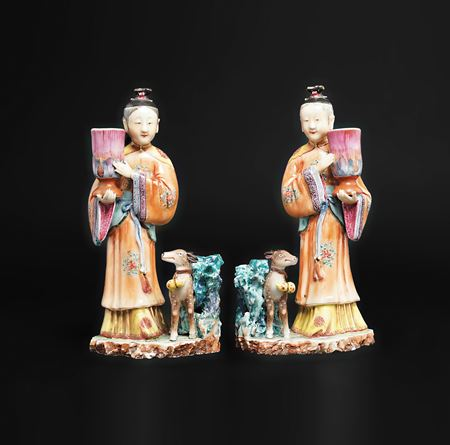 Pair of Chinese export porcelain famille rose figural candlesticks