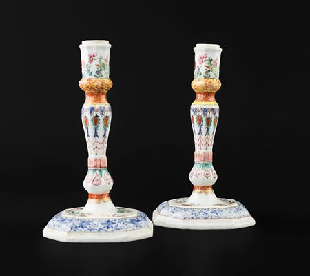 Pair of Chinese export porcelain famille rose candlesticks