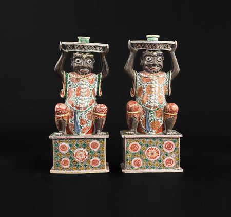Pair of Chinese export porcelain famille verte figural candlesticks, modelled as Indian bearers